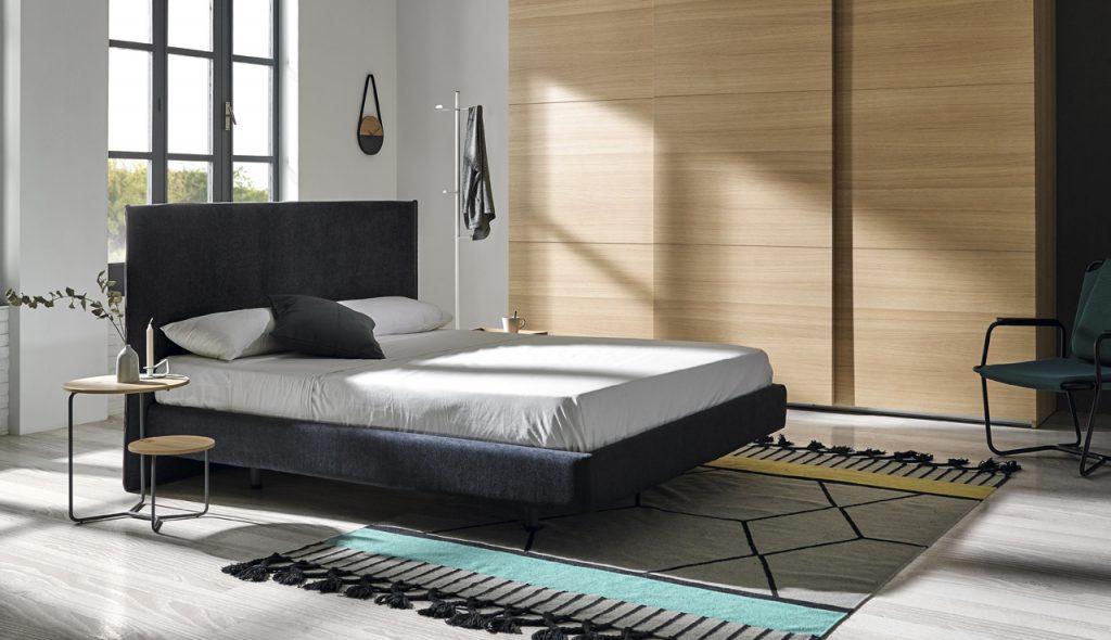 Estructura de cama tapizadas en tela gris oscuro